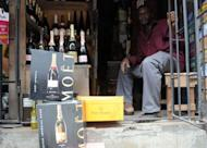 Champagne bottles displayed at a roadside shop in Lagos in April 23, 2013