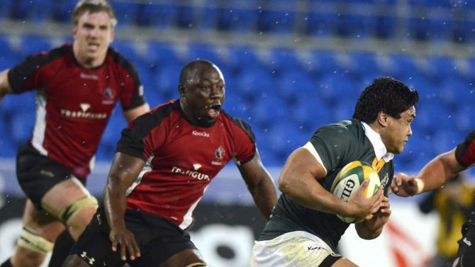 The Australian Barbarian's Ben Tapuai, right, runs with the ball against Canada's Adam Kleeberger during their rugby union match on the Gold Coast, Australia, Friday, Aug. 26, 2011. (AP Photo/Steve Holland)
