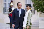 Myanmar pro-democracy leader Aung San Suu Kyi is welcomed by French President Francois Hollande at the Elysee presidential Palace in Paris, as part of her historic European tour
