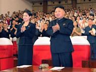 North Korean leader Kim Jong Un and a young woman believed to be Ri Sol-Ju enjoy a concert in Pyongyang on July 6. Kim is married, state media has confirmed, ending weeks of speculation about the identity of a stylish young woman seen accompanying him at official events