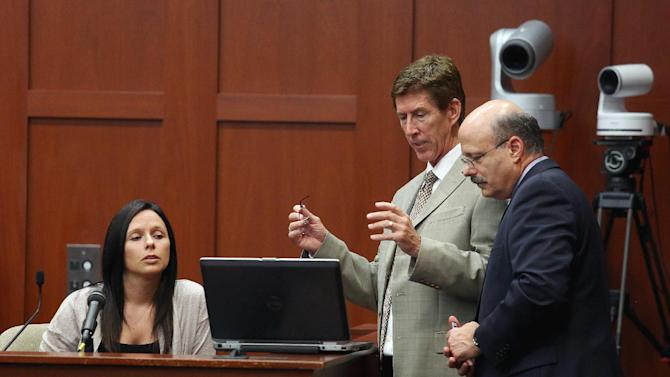 Witness Jennifer Lauer, left, answers questions for Assistant State Attorney Bernie de la Rionda, right, and defense attorney Mark O'Mara, center, during George Zimmerman's trial in Seminole circuit court in Sanford, Fla. Thursday, June 27, 2013. Zimmerman has been charged with second-degree murder for the 2012 shooting death of Trayvon Martin. (AP Photo/Orlando Sentinel, Jacob Langston, Pool)