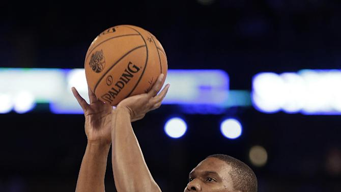 Chris Bosh, of the Miami Heat (1) shoots during the skills competition at the NBA All Star basketball game, Saturday, Feb. 15, 2014, in New Orleans. (AP Photo/Gerald Herbert)