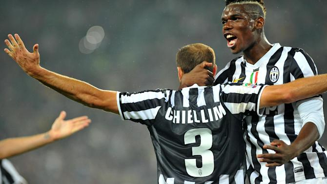 Juventus defender Giorgio Chiellini, left, celebrates after scoring with teammate  Paul Pogba, of France, during a Serie A soccer match between Juventus and AC Milan at the Juventus stadium, in Turin, Italy, Sunday, Oct. 6, 2013