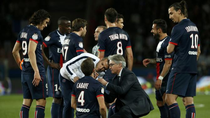 Paris St Germain's Cabaye receives medical care during their French Ligue 1 soccer match against St Etienne at the Parc des Princes Stadium in Paris
