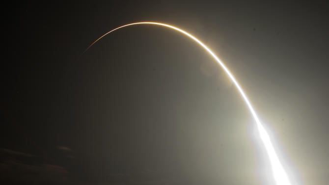 The Falcon 9 SpaceX rocket is seen during a time exsposure as it lifts off from space launch complex 40 at the Cape Canaveral Air Force Station in Cape Canaveral, Fla., early Tuesday, May 22, 2012. This launch marks the first time, a private company sends its own rocket to deliver supplies to the International Space Station.(AP Photo/John Raoux)