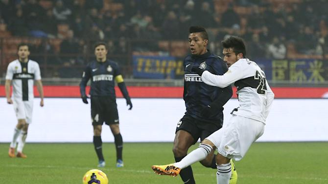 Parma forward Nicola Sansone, right, scores a goal past Inter Milan Brazilian defender Juan Jesus, during the Serie A soccer match between Inter Milan and Parma at the San Siro stadium in Milan, Italy, Sunday, Dec. 8, 2013