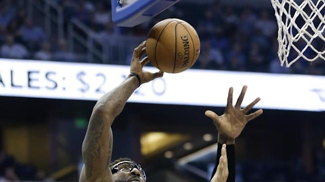 New York Knicks' Amar'e Stoudemire (1) shoots over Orlando Magic's Tobias Harris (12) in the first half of an NBA basketball game in Orlando, Fla., Monday, Dec. 23, 2013
