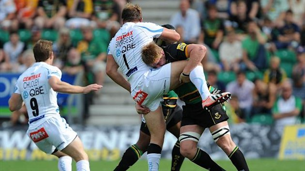Northampton Saint's GJ Van Velze tackles Exeter Chiefs' Brett Sturgess (PA Photos)
