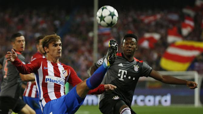Atletico Madrid's Antoine Griezmann in action with Bayern Munich's David Alaba