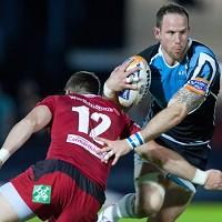 Glasgow's Graeme Morrison is tackled by Scarlets' Scott Williams