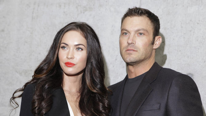 """FILE - This Sept. 25, 2010 file photo shows American actress Megan Fox posing with her husband Brian Austin Green after watching the presentation of the Emporio Armani Spring-Summer 2011 fashion collection, during the fashion week in Milan, Italy. wrote on her Facebook profile on Wednesday that she and husband Brian Austin Green welcomed a son named Noah Shannon Green on Sept. 27. She describes him as """"healthy, happy and perfect."""" She goes on to say she and Green are """"humbled"""" to be """"the parents of this beautiful soul."""" Fox and Green were married in 2010. This is their first child together. (AP Photo/Luca Bruno, file)"""