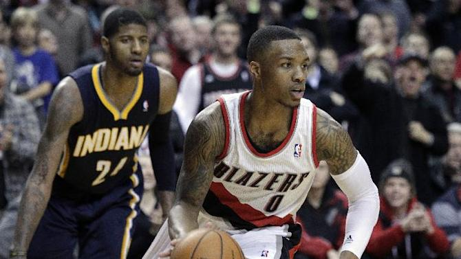Portland Trail Blazers guard Damian Lillard, right, heads downcourt ahead of Indiana Pacers forward Paul George during the second half of an NBA basketball game in Portland, Ore., Monday, Dec. 2, 2013.  Lillard scored 26 points as the Trail Blazers won 106-102