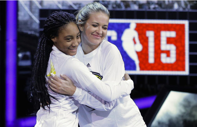 FILE - In this Feb. 13, 2015, file photo, Kristen Ledlow, right, hugs Mo'ne Davis as they are announced before the NBA All-Star celebrity basketball game in New York. Ledlow said on social media O