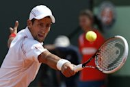 Serbia's Novak Djokovic hits a return to Italy's Potito Starace during their first round match at the French Open at Roland Garros stadium in Paris, May 28. Djokovic's bid to become the first man in 43 years to hold all four Grand Slam titles is on track after Monday's win over Starace