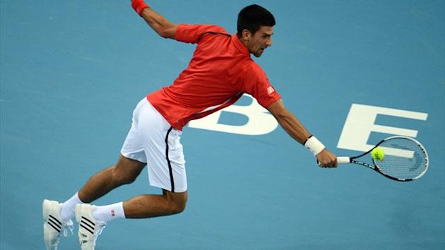 Novak Djokovic of Serbia returns to Florian Mayer of Germany during their men's singles semifinals at the China Open tennis tournament in the National Tennis Center of Beijing (AFP)