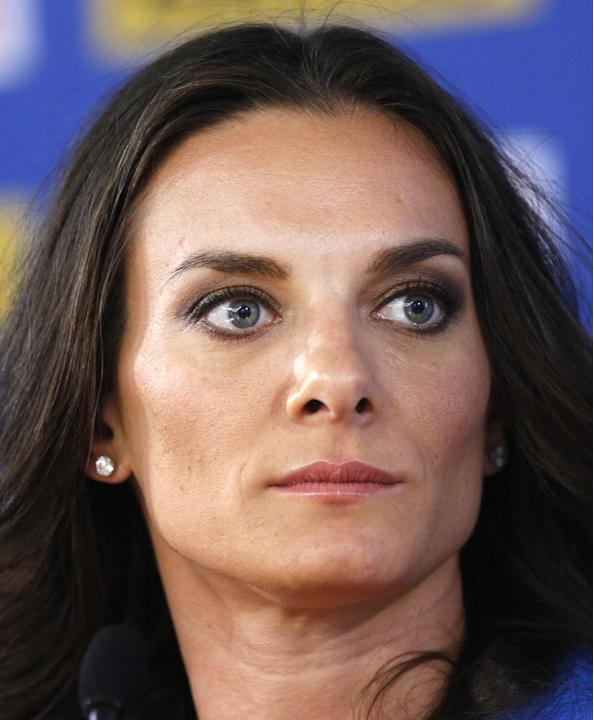 FILE - In this file photo taken on Thursday, Aug. 15, 2013, Russia's Yelena Isinbayeva, the gold medalist in the women's pole vault, listens to a question during a press conference at the World Athlet