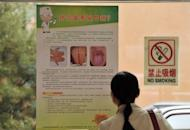 A visitor reads a notice warning about hand, foot and mouth disease at a childrens hospital in Beijing .A Chinese province has urged parents to seek immediate treatment for children showing symptoms of hand, foot and mouth disease after official figures showed 112 people died from the illness last month