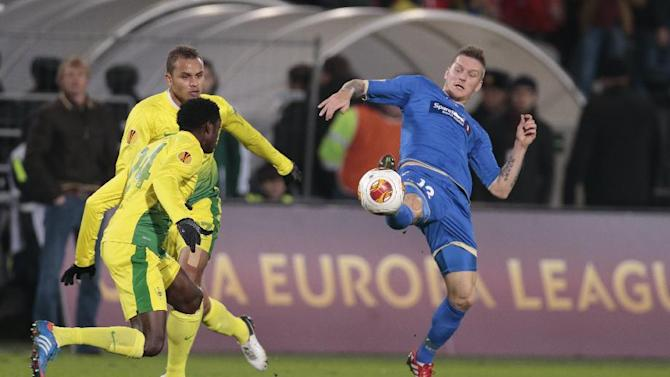 Tromso's Zdenek Ondrasek, right, kicks the ball in front of Anzhi's Ayodele Adeleye during the Europa League group K soccer match between Anzhi Makhachkala and Tromso IL at Saturn stadium in Ramenskoye, outside Moscow, in Russia, on Thursday, Oct. 24, 2013