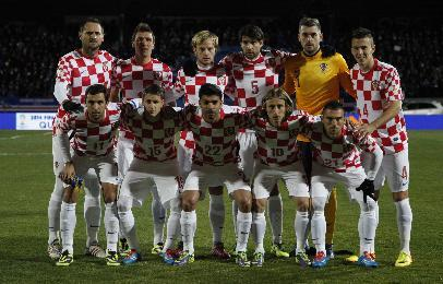 The Croatia team line up ahead of the World Cup qualifying playoff first leg soccer match against Iceland in Reykjavik, Iceland, Friday Nov. 15, 2013