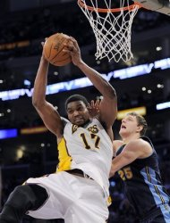 Los Angeles Lakers center Andrew Bynum grabs a rebound away from Denver Nuggets center Timofey Mozgov of Russia during the second half of an NBA first-round playoff basketball game, Sunday, April 29, 2012, in Los Angeles. The Lakers won 103-88. (AP Photo/Mark J. Terrill)