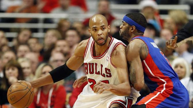 Detroit Pistons forward Josh Smith, right, defends against Chicago Bulls forward Taj Gibson, left, during the first half of an NBA basketball game in Chicago, Saturday, Dec. 7, 2013