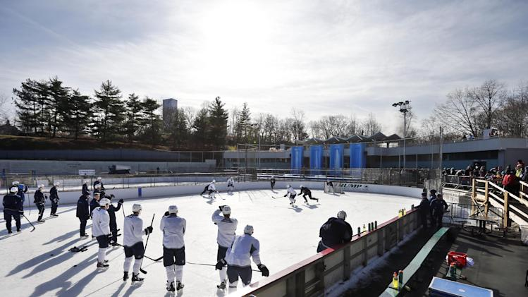 The Winnipeg Jets run a drill during NHL hockey practice at Lasker Rink in New York's Central Park, Saturday, Nov. 30, 2013
