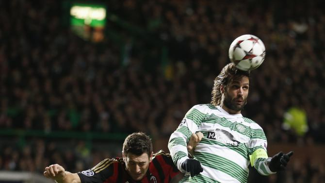 AC Milan's Daniele Bonera challenges Celtic's Georgios Samaras during their Champions League soccer match in Celtic Park Stadium, Glasgow, Scotland