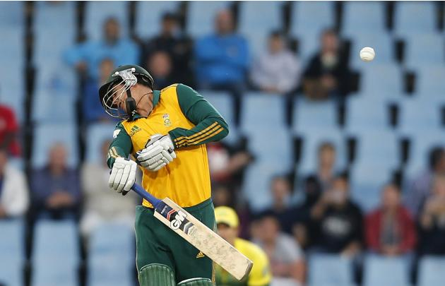 South Africa's Quinton de Kock reacts after he was hit by a ball during the final of the T20 cricket test match against Australia in Centurion