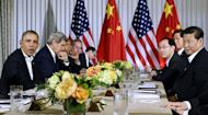 US President Barack Obama (L) speaks during a bilateral meeting with China's President Xi Jinping (R) at the Annenberg Retreat at Sunnylands in Rancho Mirage, California, on June 7, 2013. Ditching the crushing formality of US-China summits, Xi and Obama met in Rancho Mirage, a playground of past presidents and the powerful