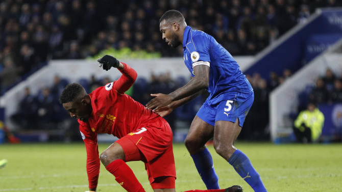 Liverpool's Divock Origi in action with Leicester City's Wes Morgan