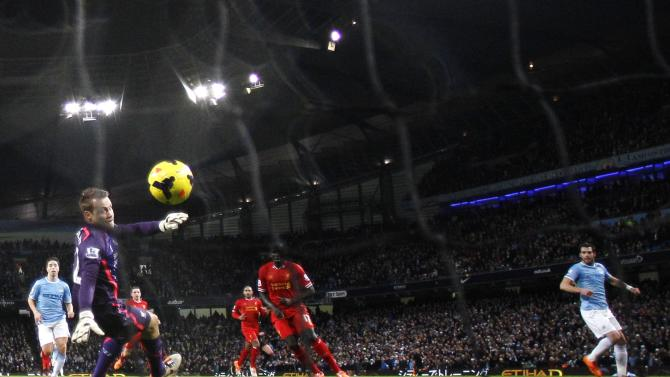 Manchester City's Negredo scores a goal against Liverpool during their English Premier League soccer match in Manchester