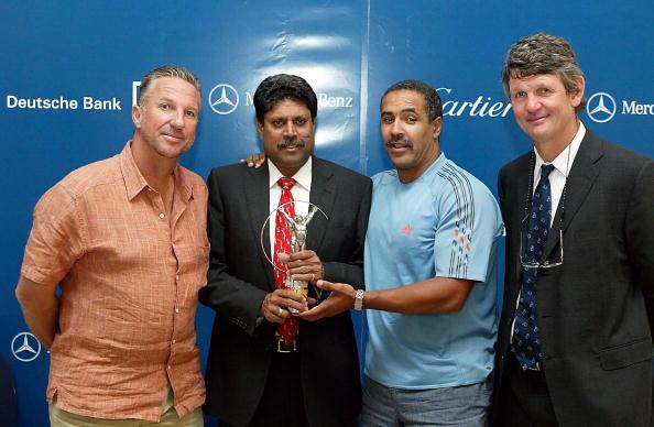 JOHANNESBURG ? MARCH 25:  Sporting Legend and Laureus World Sports Academy members (L-R) Ian Botham, Kapil Dev, Daley Thompson and Morne du Plessis pose March 25, 2003 in Johannesburg, South Africa at