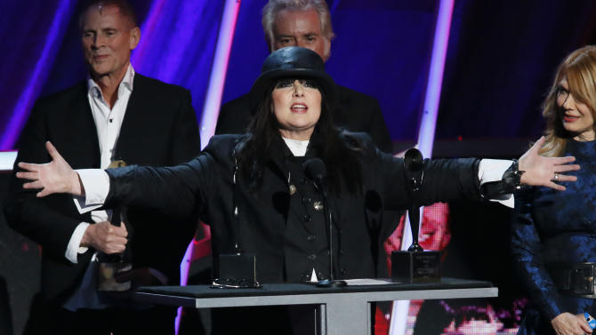 Ann Wilson of the band Heart speaks alongside sister Nancy Wilson, right, as Heart is inducted into the Rock and Roll Hall of Fame during the Rock and Roll Hall of Fame Induction Ceremony at the Nokia Theatre on Thursday, April 18, 2013 in Los Angeles. (Photo by Danny Moloshok/Invision/AP)