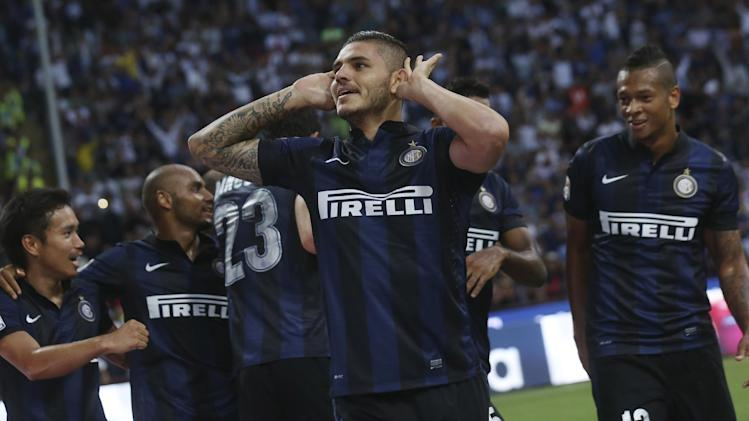 Inter Milan forward Mauro Icardi, of Argentina, celebrates after scoring during a Serie A soccer match between Inter Milan and Juventus, at the San Siro stadium in Milan, Italy, Saturday, Sept. 14, 2013. Inter and Juventus played to a 1 - 1 tie