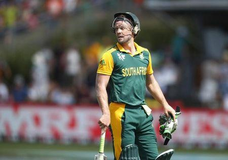 South Africa's batsman AB de Villiers looks back to the pitch as he walks off the field after being caught out by Zimbabwe's Craig Ervine during their Cricket World Cup match in Hamilton