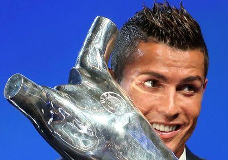 Real Madrid's Cristiano Ronaldo of Portugal reacts as he receives the Best Player UEFA 2015/16 Award during the draw ceremony for the 2016/2017 Champions League Cup soccer competition at Monaco's Grimaldi in Monaco