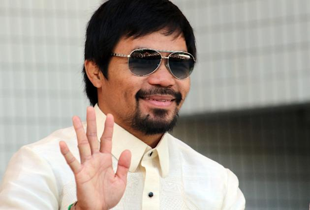Manny Pacquiao, pictured on September 19, 2015, is to attend the World Boxing Championships in Doha