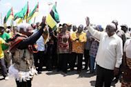 President of Mozambique Armando Guebuza (R) greets supporters on his arrival in Chimoio, capital of the Manica Province, on October 30, 2013