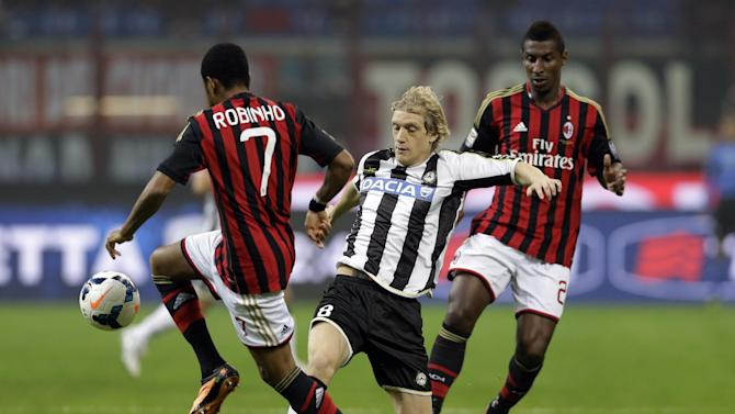 Udinese's Dusan Basta of Serbia, center, challenges AC Milan's Robinho, left, during a Serie A soccer match between AC Milan and Udinese, at the San Siro stadium in Milan, Italy, Saturday, Oct. 19, 2013