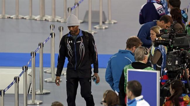 Shani Davis of the U.S. leaves the arena after the men's 1,500-meter speedskating race at the Adler Arena Skating Center during the 2014 Winter Olympics in in Sochi, Russia, Saturday, Feb. 15, 2014. (AP Photo/Matt Dunham)