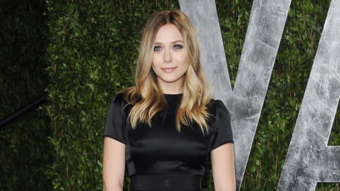 """FILE - This Feb. 26, 2012 file photo shows actress Elizabeth Olsen arrives at the Vanity Fair Oscar party in West Hollywood, Calif. Olsen will soon be a star-crossed lover _ she'll star in an off-Broadway version of Shakespeare's """"Romeo & Juliet."""" Classic Stage Company said Thursday that the younger sister of Mary-Kate and Ashley Olsen will help will kick off their 2013/2014 season. (AP Photo/Evan Agostini, file)"""