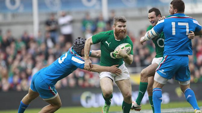 Ireland's Gordon D'Arcy, centre, is tackled by Italy's Michele Campagnaro, left, during their Six Nations Rugby Union international match at the Aviva Stadium, Dublin, Ireland, Saturday, March 8, 2014. (AP Photo/Peter Morrison)