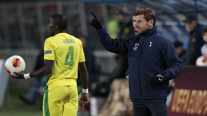 Tottenham coach Andre Villas-Boas, right, watches his team during the Europa League group K soccer match between Anzhi Makhachkala and Tottenham Hotspur, at Saturn stadium in Ramenskoye, outside Moscow, Russia, on Thursday, Oct. 3, 2013