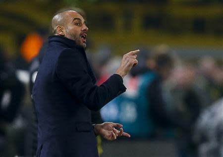 Bayern Munich's coach Guardiola gestures during their German first disvison Bundesliga soccer match against Borussia Dortmund's in Dortmund