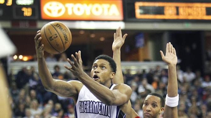Sacramento Kings forward Rudy Gay (8) drives to the basket past Philadelphia 76ers defender Evan Turner (12) during the second half of an NBA basketball game in Sacramento, Calif., on Thursday, Jan. 2, 2014. The 76ers won 113-104