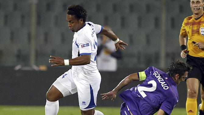 Pandurii's Eic Pereira, of Brazil, dribbles past Fiorentina's Gonzalo Rodriguez, of Argentina, during an Europa League, group E match, between Fiorentina and Pandurii, at the Artemio Franchi stadium in Florence, Italy, Thursday, Oct.  24, 2013
