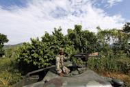 """A soldier patrols the border area between the states of Jalisco and Nayarit, in Magdalena, on September 27, 2012. Police have detained the alleged leader of the Juarez drug cartel, a 47-year-old man known as """"Ugly Betty,"""" according to authorities"""