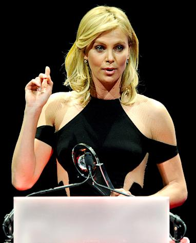 "Charlize Theron Jokes: ""I Should Have Gotten a Boob Job 10 Years Ago"""