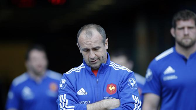France's rugby team head coach Philippe Saint-Andre arrives for a training session at the Stade de France stadium, in Saint Denis, outside Paris, Friday, March 14, 2014. France will play Ireland during a Six Nations Rugby Union match on March 15. (AP Photo/Christophe Ena)