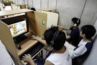 Children play computer games in Singapore. Snubbing the outdoors for books, video games and TV is the reason up to nine in ten school-leavers in big East Asian cities are near-sighted, according to a study published on Friday